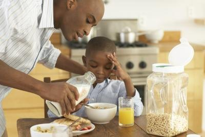 father making breakfast for child