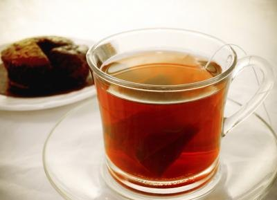 Black tea's caffeine content falls between that of green tea and coffee.