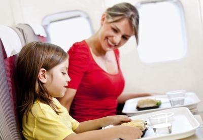 woman on plane with adopted child