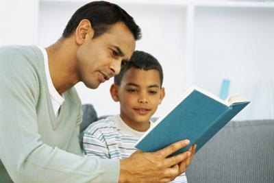 Children learn and develop when listening to adults read.