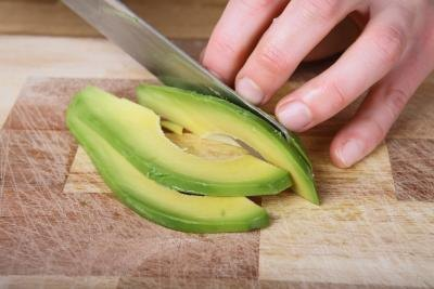 Woman slicing avocado