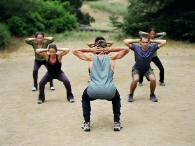 Work out group doing squats
