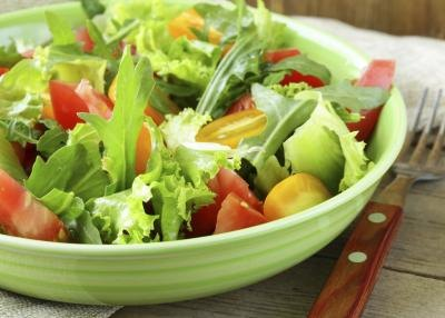 A fresh salad tossed with tomatoes and arugula.