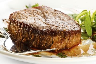 A close up of a grilled steak.