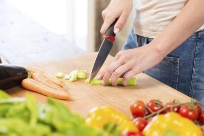 Woman cutting veggies