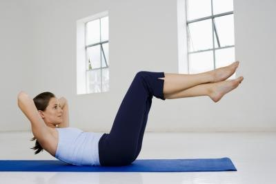 Woman doing sit ups.