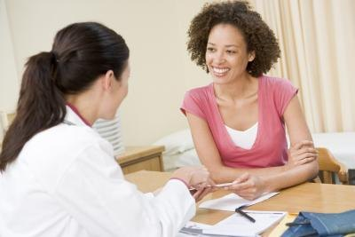 Woman talking with physician