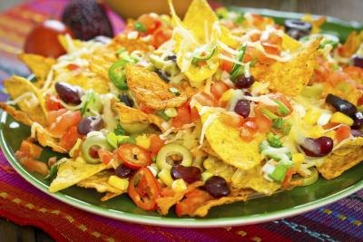 Plate of nachos with cheese and sour cream