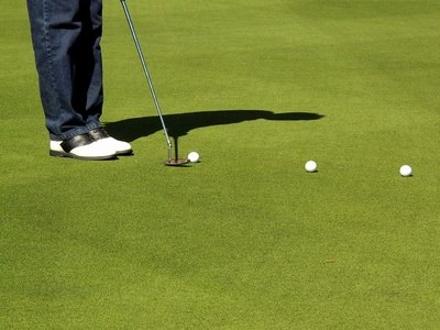 "A golf shoe with a fuller ""last"" will more adequately handle a wider foot."