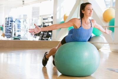 Set your exercise ball in a base until you are able to keep your balance.