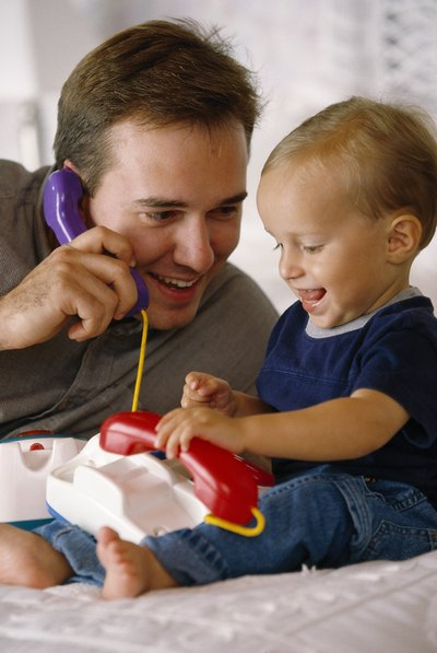 Toddlers love talking to their parents on the telephone.