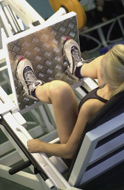 The seated leg press helps to build glute and quad muscles.