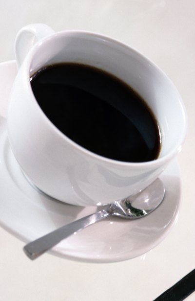 Coffee will give you energy and supress the appetite.