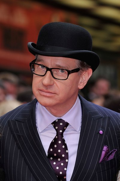Actor Paul Feig in a traditional bowler and pinstripe suit