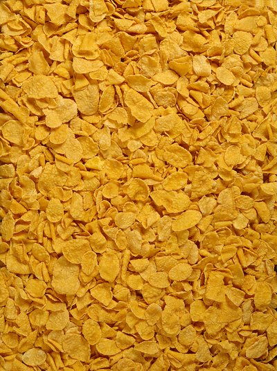 Make your own crunchy coating by smashing corn flakes and mixing with garlic powder, paprika, parsley and Parmesan cheese.