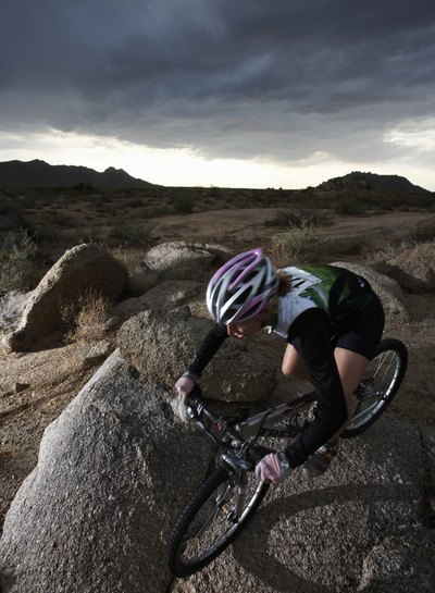 Race car drivers may ride mountain bikes as part of their fitness routines.
