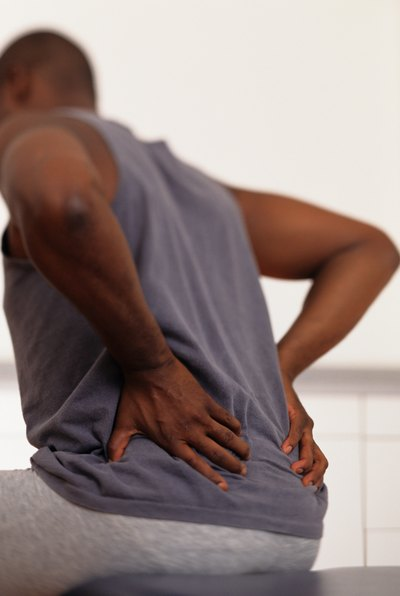 Head to the ER if back pain is accompanied by numbness or if tolerable pain persists more than six weeks.