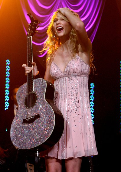 Taylor Swift's sparkly pink dress is playful and fun.