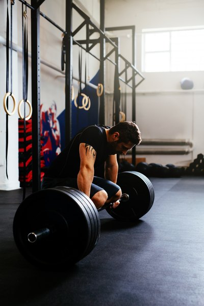 Push the limits of your leg strength with heavy barbell deadlifts.