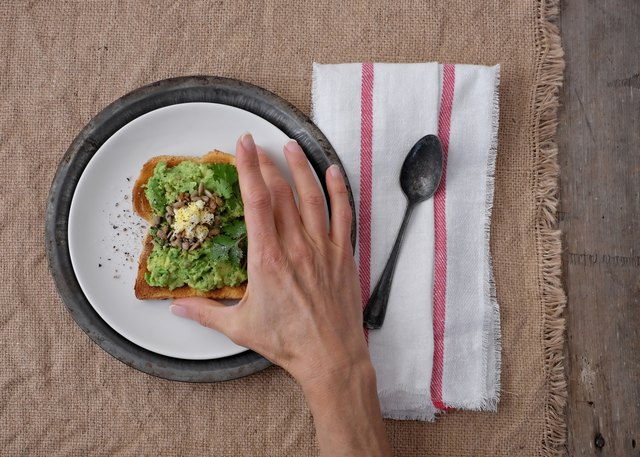 Toast with egg and avocado includes healthy fats that will keep you feeling full.