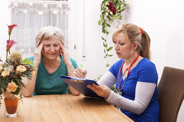 Home healthcare nurse visiting patient suffering from headache