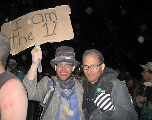 "This brave guy jokingly carried a sign that said ""I am the 1%"" at Burning Man 2011 (during a time when the Occupy Wall St movement was going strong). He danced with us in the dust until the sun came up."
