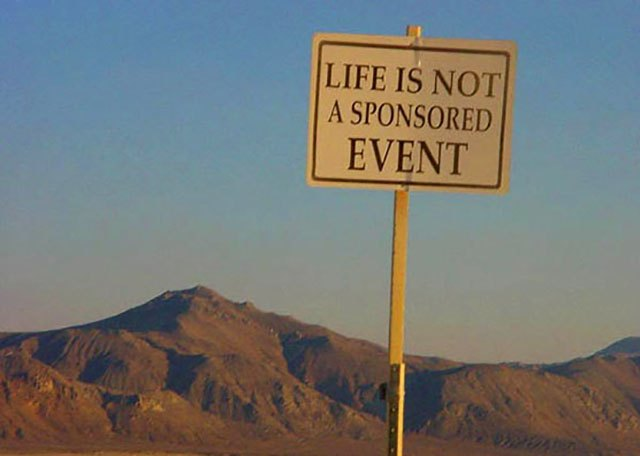 """Life Is Not a Sponsored Event."" A sign photographed at Burning Man 2001."