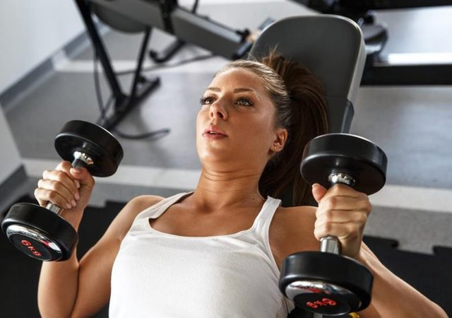Instead of a barbell, you can use dumbbells to complete a press.