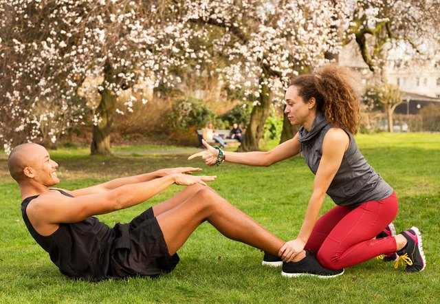 Grab your running buddy and work on your abs together.