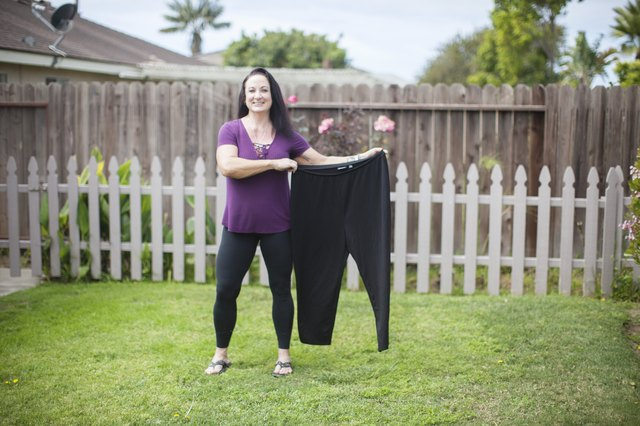 Stacy went down almost 25 pants sizes and lost 195 pounds.