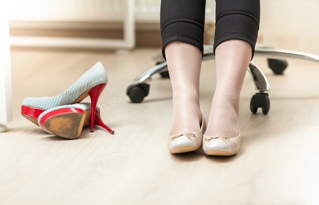 Wear flats on your way to work, then change into a pair of heels you keep at your desk.