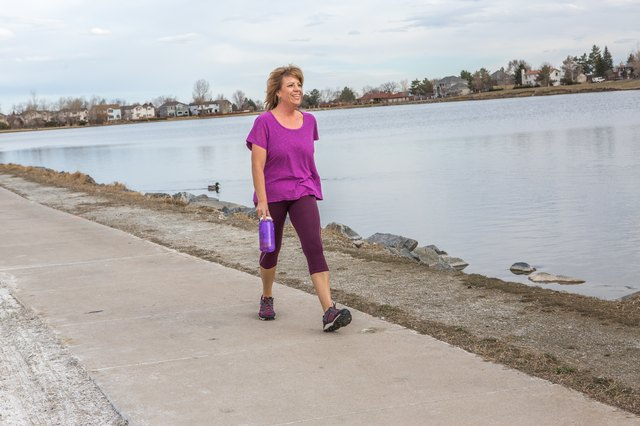 Julia power walks 5 miles each day around the lake near her home.