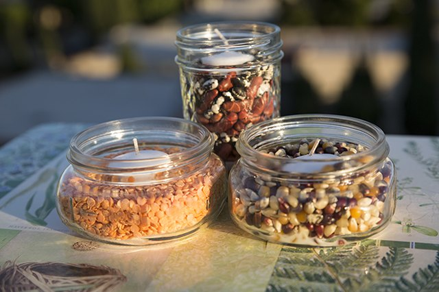 Light the night with votive candles nestled in beans and grains.