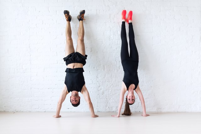 A wall can provide stability when you're learning how to kick up into handstand.