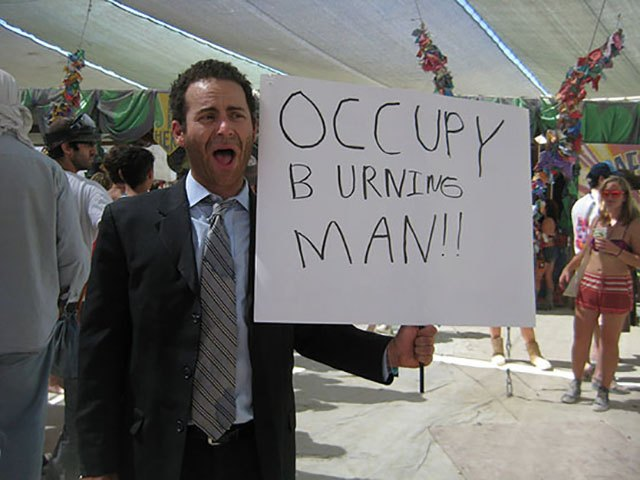 """Occupy Burning Man!!"" In 2011 (when the Occupy Wall St movement was going on) a bunch of pseudo-protestors staged some mock-protests at Burning Man."