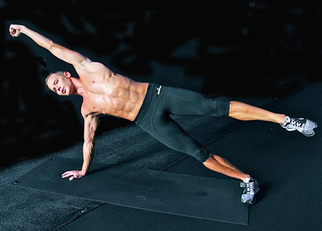 Amp up the side plank by extending your top arm overhead as you extend the top leg.