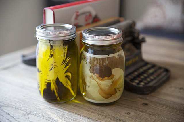 Mason jars filled with olive oil give a vintage look to photographs.
