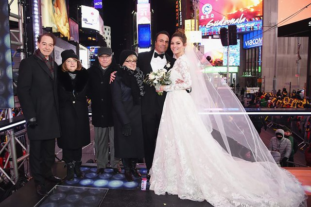 Menounos married Kevin Undergaro, her boyfriend of 20 years, in a surprise ceremony on live TV  on New Year's Eve in New York City's Times Square. Their parents, including her mom Litsa, were there.