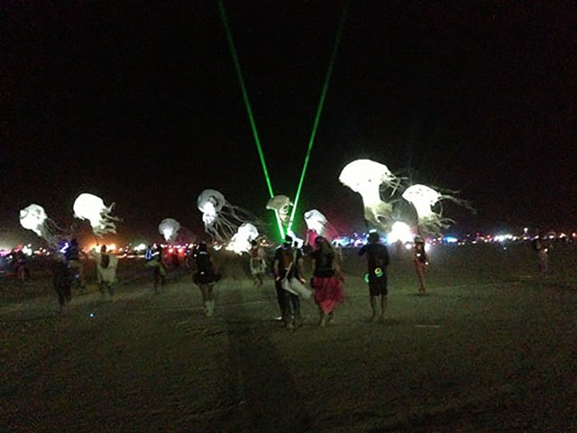 The Billion Jellyfish Bloom moves across the playa at Burning Man 2013.