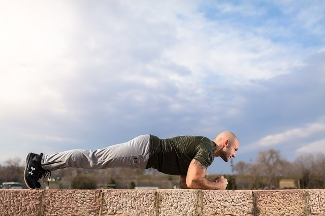 Planks will develop core strength at home.