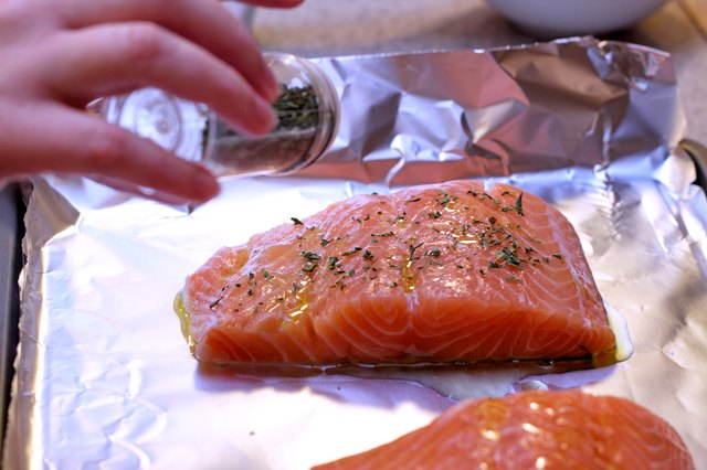 How to bake salmon in the oven per the pound livestrong season the salmon to taste for a fresh tasting topping that helps keep the fish moist during cooking finely chop some fresh herbs basil dill ccuart Image collections