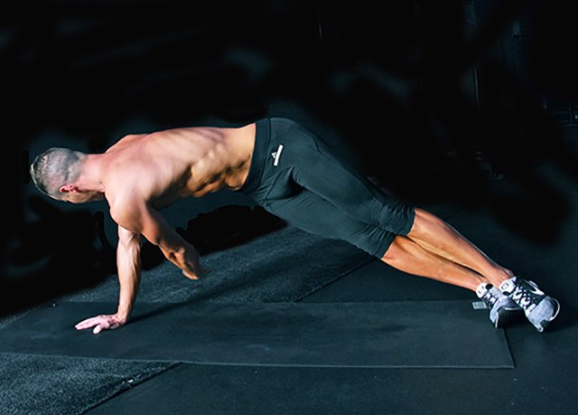 From your high side plank, each the top arm under the body reaching for the wall behind.