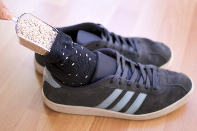 Fill Clean Socks With Kitty Litter And Place The Socks Inside The Shoes.  Leave Them Overnight. Kitty Litter Absorbs Odors And Can Help Eliminate The  Smell.