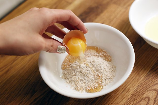 How to make an easy three step oatmeal facial mask livestrong crack an egg without breaking the yolk pour out and discard the egg white and pour the yolk into the small bowl with the honey and oatmeal mixture solutioingenieria Gallery