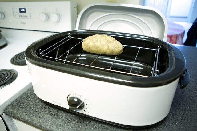 Place The Potatoes Into The Roaster Oven, Either On The Rack Or On The  Bottom Of The Cooking Well. Fit The Lid Securely In Place.