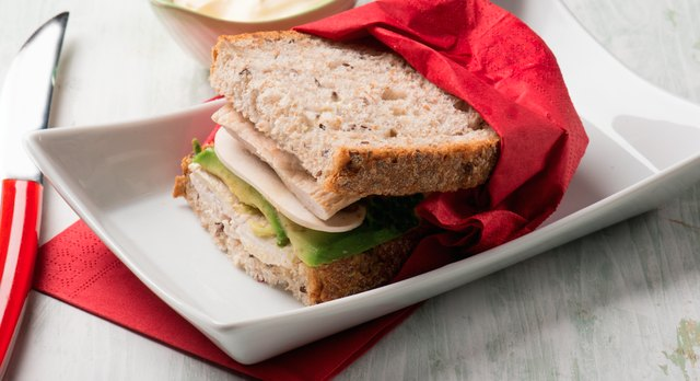 A half turkey-and-avocado sandwich is a healthy meal for prediabetics.