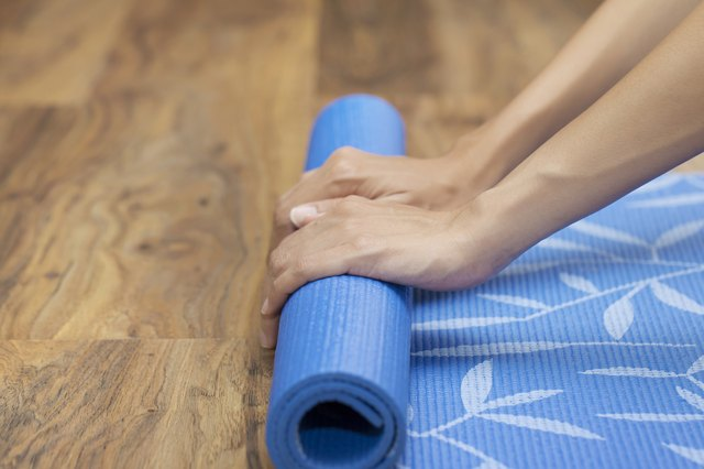 A partially rolled up yoga mat can provide cushion under your knees, hips or butt.