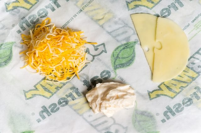 Subway cheese options include cheddar, provolone cheese and Swiss cheese.