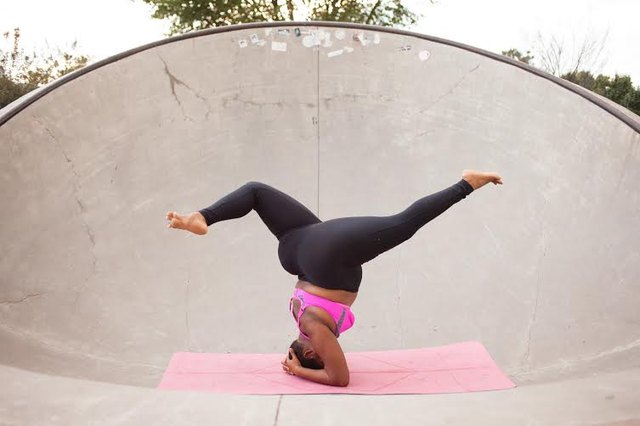 Jessamyn Stanley in Supported Headstand pose.