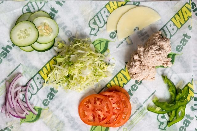 Subway sandwich toppings include onions, tomatoes and provolone cheese.